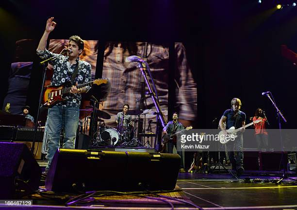 John Mayer and Keith Urban perform on stage during the 2013 Crossroads Guitar Festival at Madison Square Garden on April 12 2013 in New York City