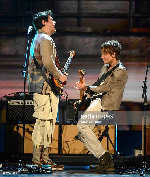 John Mayer and Keith Urban perform onstage at The Night That Changed America A GRAMMY Salute To The Beatles at Los Angeles Convention Center on...