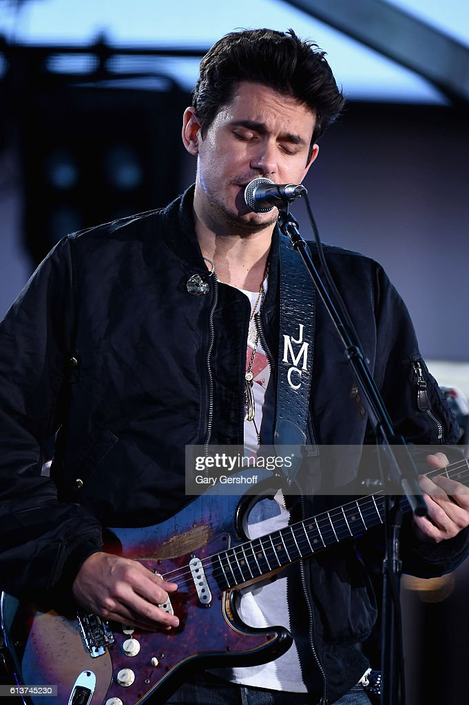 John Mayer performs at Times Square on October 9, 2016 in New York City.