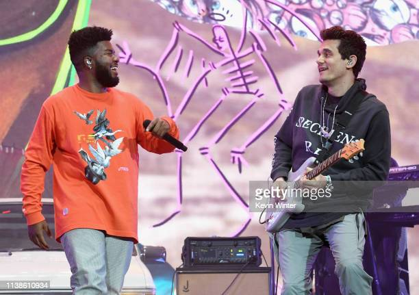 John Mayer performs with Khalid at Coachella Stage during the 2019 Coachella Valley Music And Arts Festival on April 21 2019 in Indio California