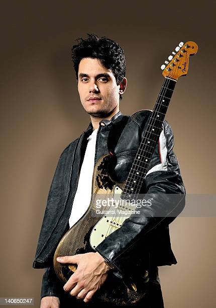 John Mayer posing with a Fender Stratocaster electric guitar at the Mandarin Hotel January 22 2010