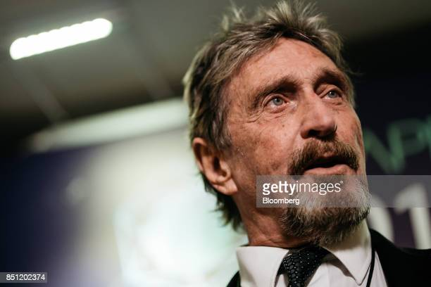 John McAfee, founder of McAfee Associates Inc. And chief cybersecurity visionary at MGTCapital Investments Inc., speaks during a Bloomberg...