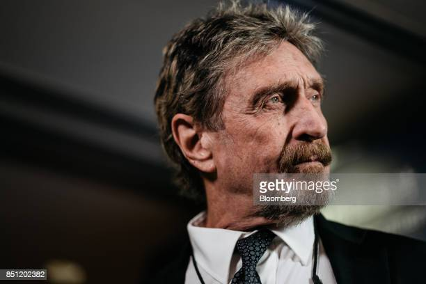 John McAfee, founder of McAfee Associates Inc. And chief cybersecurity visionary at MGTCapital Investments Inc., listens during a Bloomberg...