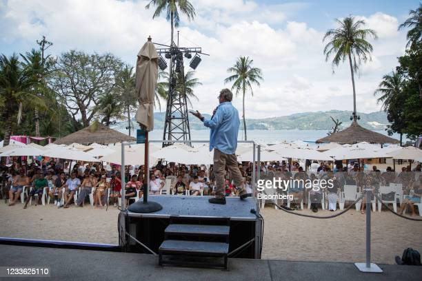 John McAfee, founder of McAfee Associates Inc., speaks at a Coinsbank Blockchain Cruise Asia conference event at Paradise Beach in Phuket, Thailand,...