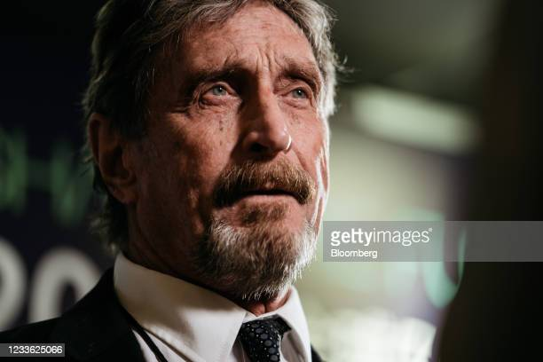 John McAfee, founder of McAfee Associates Inc., speaks during a Bloomberg Television interview on the sidelines of the Shape the Future: Blockchain...