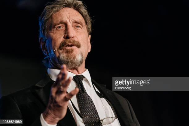 John McAfee, founder of McAfee Associates Inc., speaks during the Shape the Future: Blockchain Global Summit in Hong Kong, China, on Wednesday, Sept....