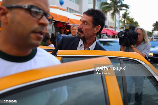John McAfee gets into a cab in front of the Beacon Hotel where he is staying after arriving last night from Guatemala on December 13, 2012 in Miami...