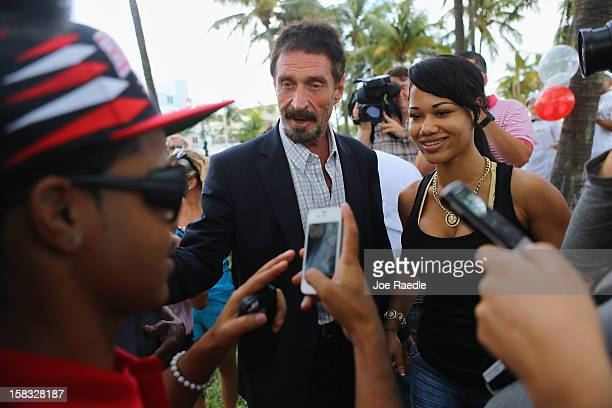 John McAfee interacts with people after speaking to reporters outside of the Beacon Hotel where he is staying after arriving last night from...