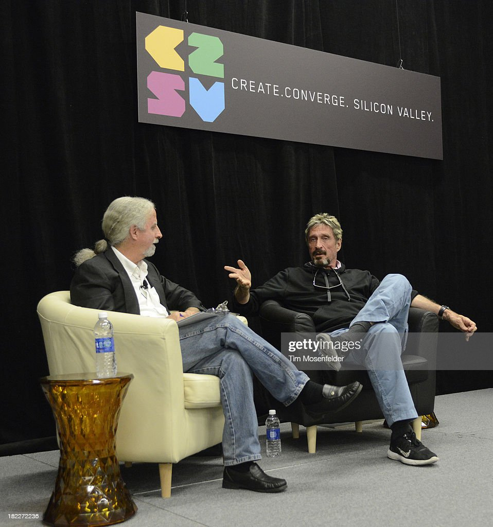 John McAfee (R) participates in a fireside chat at the C2SV Technology Conference Day Three at McEnery Convention Center on September 28, 2013 in San Jose, California.