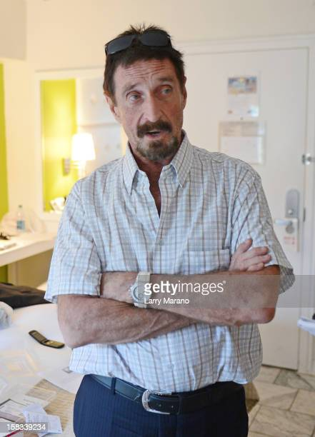 John McAfee poses for a portrait at his hotel in South Beach on December 13 2012 in Miami Beach Florida