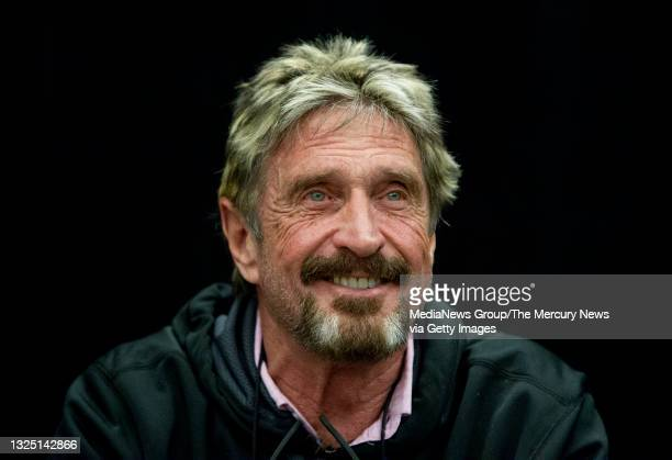 """John McAfee reacts to a question at the """"Fireside Chat with John McAfee"""" talk during the C2SV Technology Conference + Music Festival at the McEnery..."""