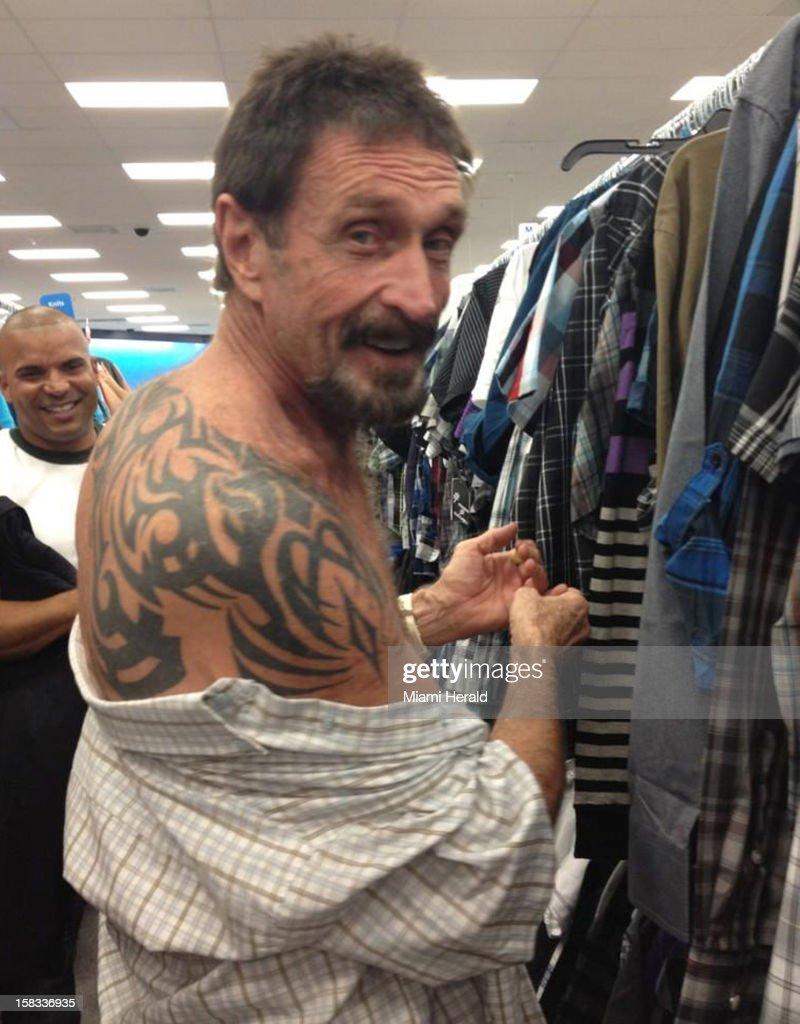 John McAfee shows off his tatoo while shopping in South Beach, Miami, on Thursday, December 13, 2012. John McAfee, the controversial guru of computer anti-virus software, denied Thursday in Miami Beach that he's been interviewed by Internal Revenue Service and FBI agents after arriving the previous night following deportation from Guatemala.