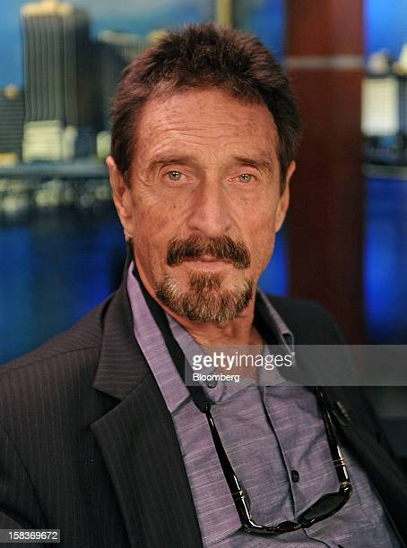 John McAfee sits for a photograph following an interview in Miami Florida US on Friday Dec 14 2012 McAfee who is wanted for questioning in the...