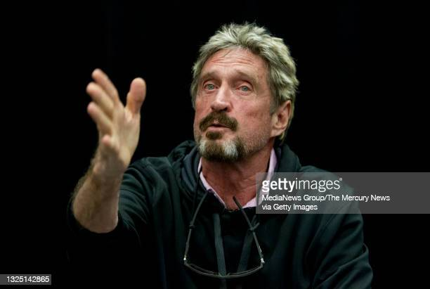"""John McAfee speaks at the """"Fireside Chat with John McAfee"""" talk during the C2SV Technology Conference + Music Festival at the McEnery Convention..."""
