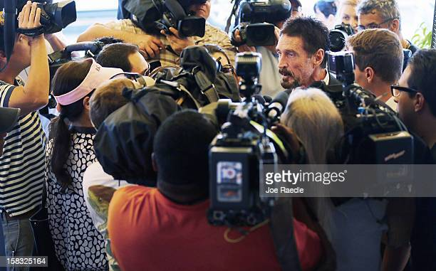 John McAfee talks to the media outside Beacon Hotel where he is staying after arriving last night from Guatemala on December 13 2012 in Miami Beach...