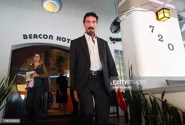 John McAfee walks out of the Beacon Hotel in Miami Beach Florida on December 13 after arriving in Miami International Airport from Guatemala on...