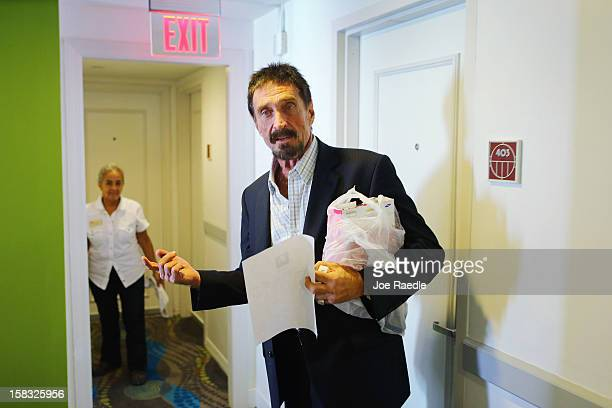 John McAfee walks to his room at the Beacon Hotel where he is staying after arriving last night from Guatemala on December 13, 2012 in Miami Beach,...