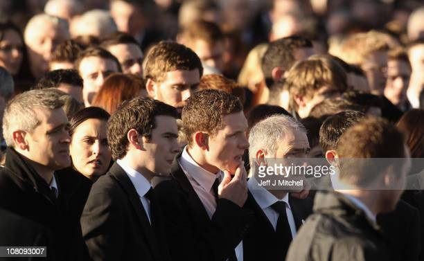 John McAreavey husband of Michaela McAreavey and her father Mickey Harte walk behind her coffin on January 17 2011 in Ballygawley Northern Ireland...