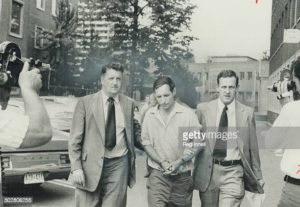 John McBeth Finlayson 37 the object of a nationwide search in the mutilationkilling of 9yearold Kirkland Deasley is escorted into Metro police...