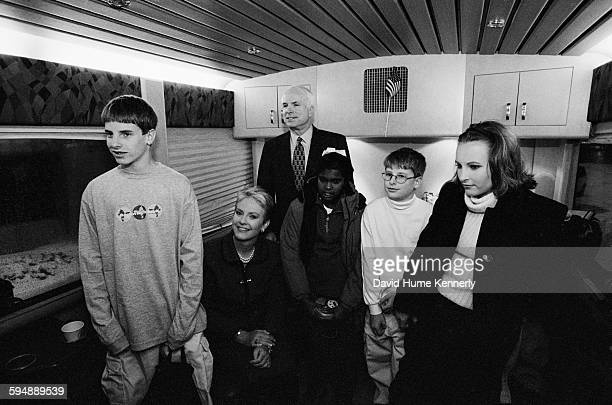 John McCain on the campaign bus with his family son Jack wife Cindy daughter Bridget son Jimmy and daughter Meghan January 31 2000 in Keene New...