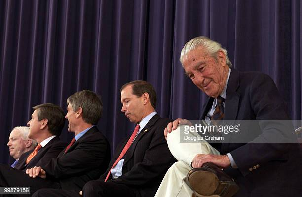 John McCain RAriz Gordon Smith ROreMark Udall DColo and Tom Udall DNM sit with Stewart Udall during a ceremony honoring him and the late Rep Morris...