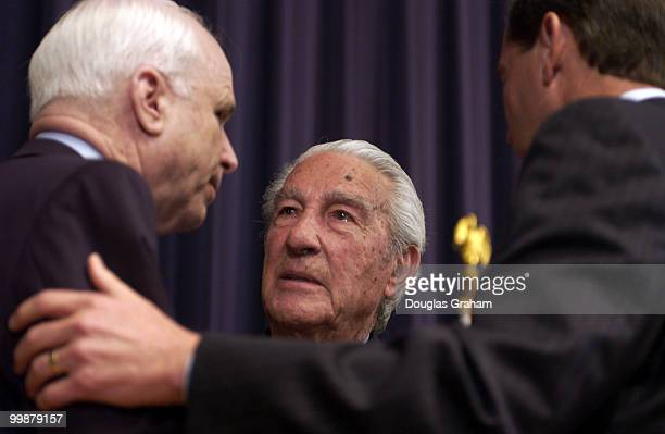 John McCain RAriz Stewart Udall and Tom Udall DNM talk after a ceremony honoring Stewart and the late Rep Morris Udall DAriz by opening a traveling...