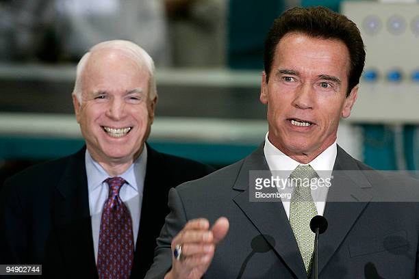 John McCain senator of Arizona and Republican presidential candidate left listens as Arnold Schwarzenegger governor of California right endorses...