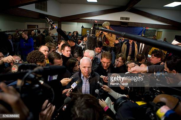 John McCain, U.S. Senator and Republican presidential hopeful, answers reporters questions after a speech at a campaign stop in Des Moines, Iowa.