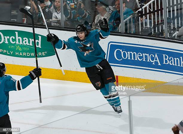 John McCarthy of the San Jose Sharks celebrates his goal against the Columbus Blue Jackets during an NHL game on February 7 2014 at SAP Center in San...
