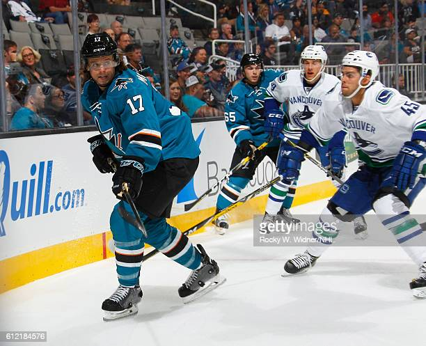 John McCarthy of the San Jose Sharks clears the puck against the Vancouver Canucks at SAP Center on September 27 2016 in San Jose California