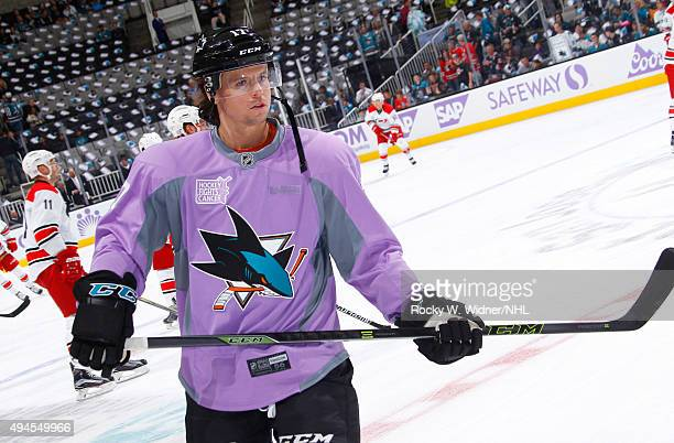 John McCarthy of the San Jose Sharks wears a lavender jersey in support of the Hockey Fights Cancer campaign prior to the game against the Carolina...