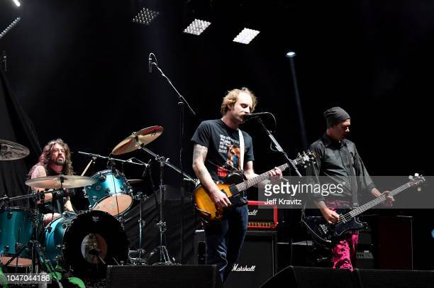 John McCauley of Deer Tick joins Dave Grohl and Krist Novoselic of Nirvana during Cal Jam 18 at the San Manuel Amphitheater on October 6,2018 in San...