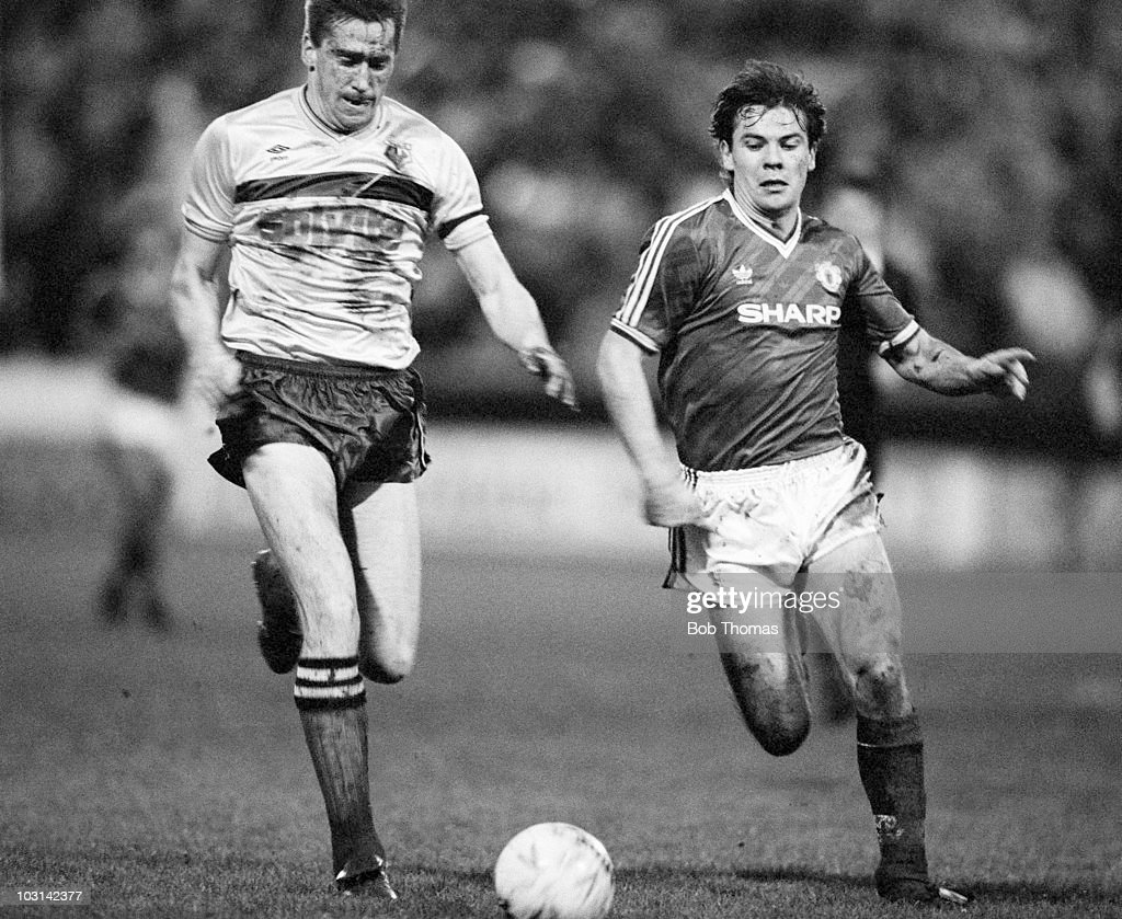 John McClelland of Watford (left) and Brian McClair of Manchester United race for the ball during a Division One football match held at Vicarage Road, Watford on 2nd January 1988. Manchester United beat Watford 1-0.