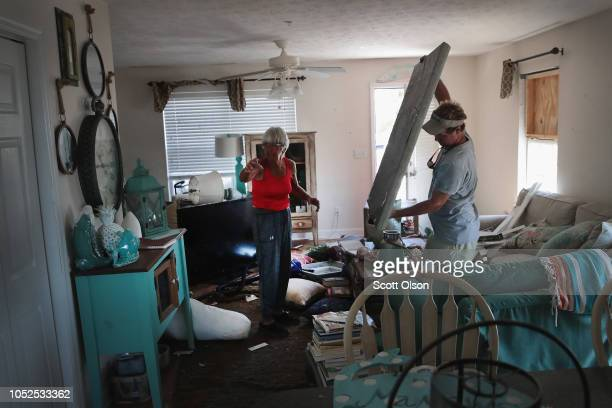 John McClenny helps LeClaire Bryan mother of country music artist Luke Bryan recover items from her home after it was severely damaged by Hurricane...