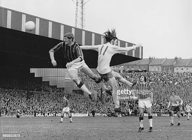 John McCormick of Crystal Palace challenges Arsenal centre forward Charlie George for the ball in the air during their English League Division One...