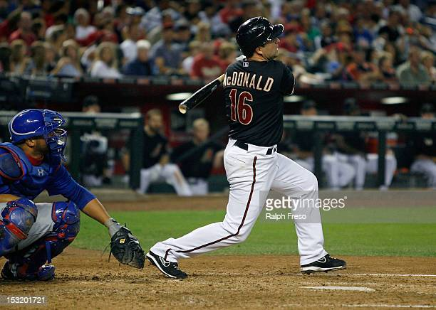 John McDonald of the Arizona Diamondbacks hits a fly ball to left field against the Chicago Cubs during a MLB game at Chase Field on September 29...
