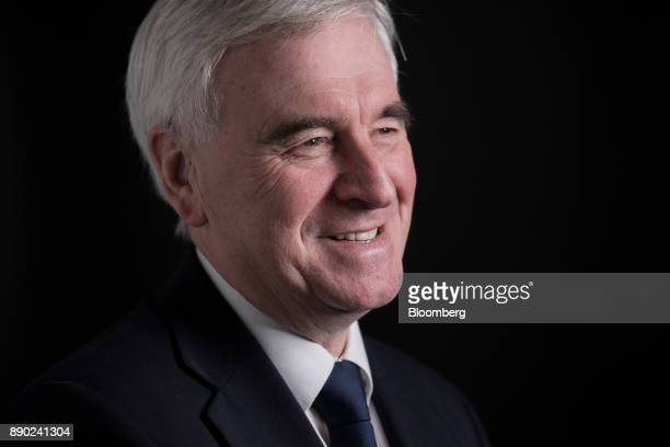 John McDonnell finance spokesman for the UK opposition Labour party poses for a photograph following a Bloomberg Television interview in London UK on...