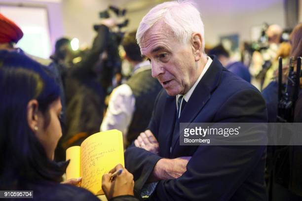 John McDonnell finance spokesman for the UK opposition Labour party speaks to a journalist on the closing day of the World Economic Forum in Davos...