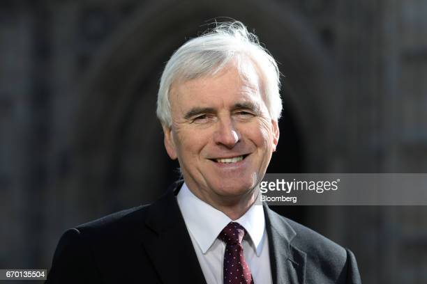 John McDonnell finance spokesman of the UK opposition Labour party poses for a photograph following a Bloomberg Television interview in London UK on...