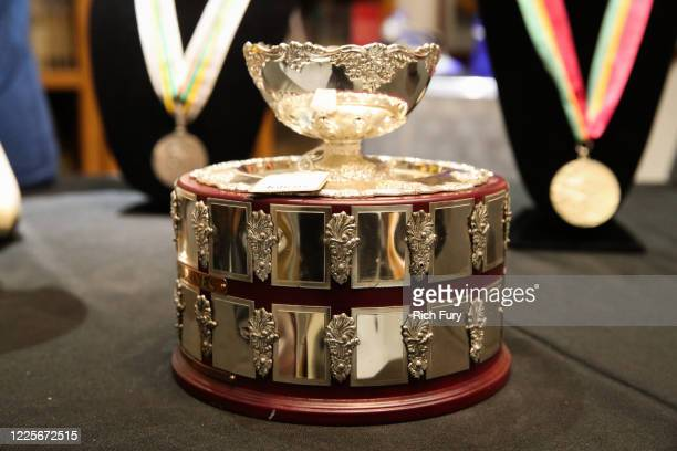 John McEnroe 1984 Davis Cup runner-up trophy is displayed at a press preview for sports legends featuring Kobe Bryant, FIFA and Olympic Medals at...