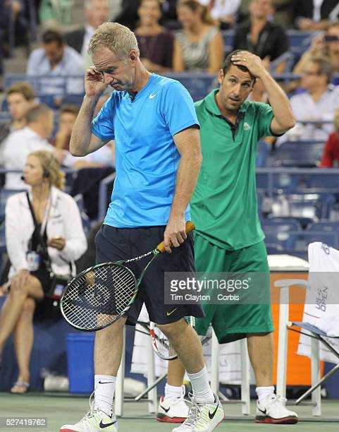 John McEnroe and Adam Sandler in action during the exhibition tennis double match between John McEnroe and Adam Sandler and Jim Courier and Kevin...