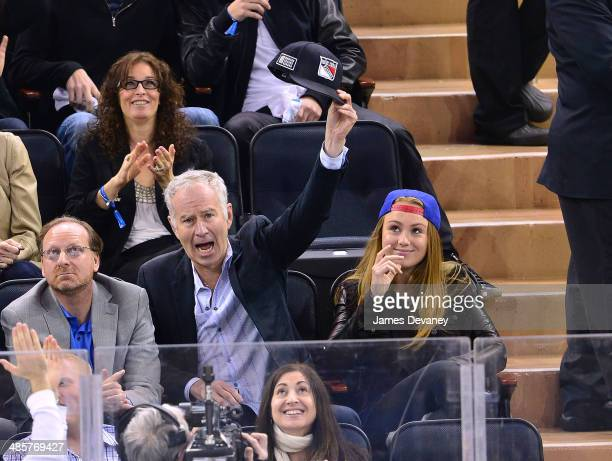 John McEnroe and Anna McEnroe attend the Philadelphia Flyers vs New York Rangers playoff game at Madison Square Garden on April 20 2014 in New York...