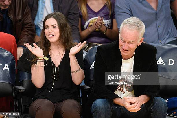 John McEnroe and Ava McEnroe attend a basketball game between the Miami Heat and the Los Angeles Lakers at Staples Center on March 30 2016 in Los...