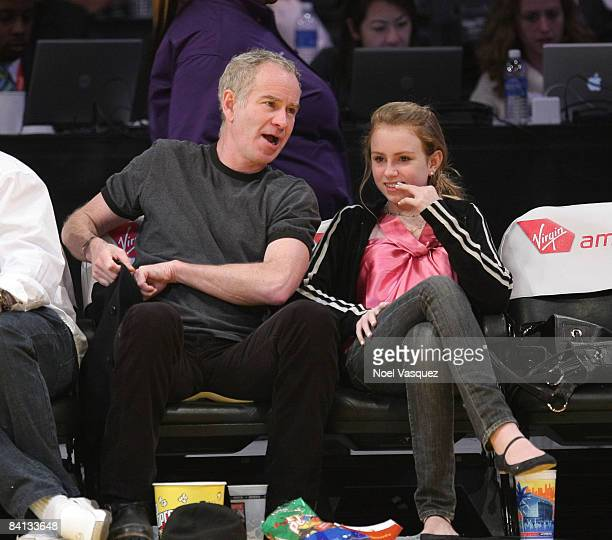 John McEnroe and Ava McEnroe attend the Los Angeles Lakers vs Golden State Warriors game at the Staples Center on December 28 2008 in Los Angeles...