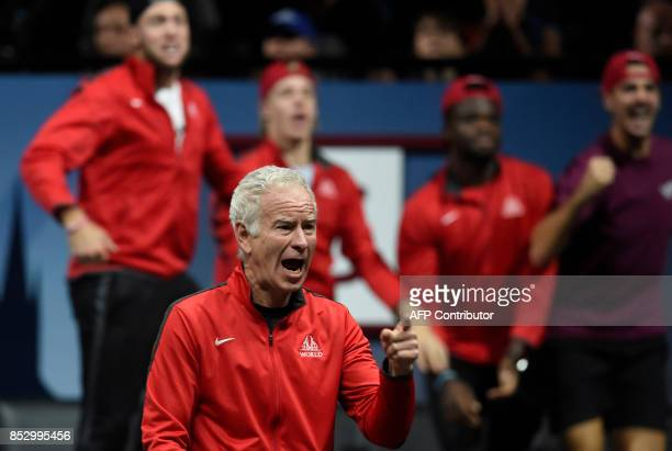 US John McEnroe and captain of Team World reacts during a match between US John Isner of Team against Spanish Rafael Nadal of Team Europe during...
