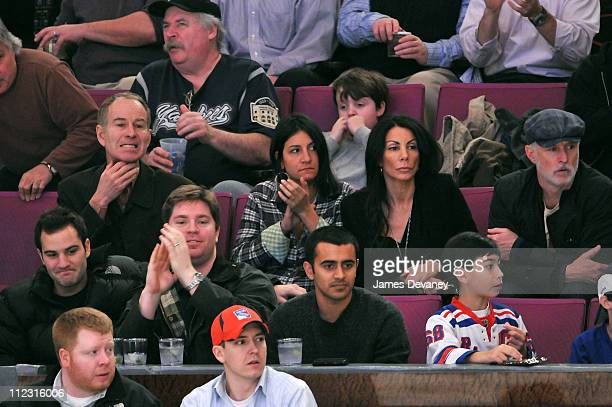 John McEnroe and Danielle Staub attend the Pittsburgh Penguins vs New York Rangers game at Madison Square Garden on January 25 2010 in New York City