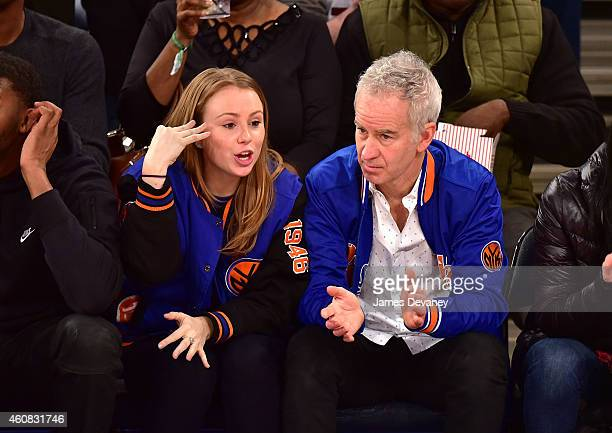 John McEnroe and daughter Anna McEnroe attend New York Knicks vs Washington Wizards game at Madison Square Garden on December 25 2014 in New York City