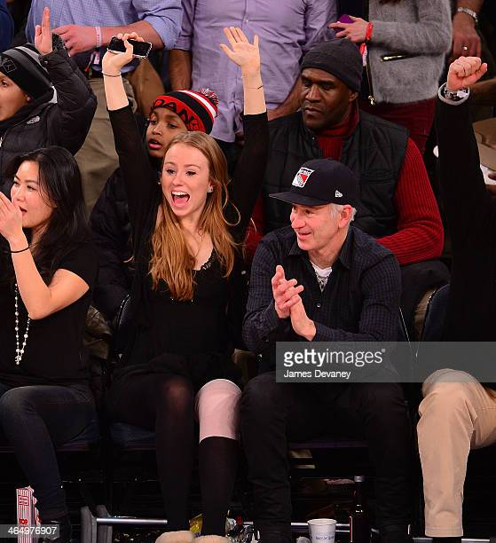 John McEnroe and daughter Anna McEnroe attend the Charlotte Bobcats vs New York Knicks game at Madison Square Garden on January 24 2014 in New York...