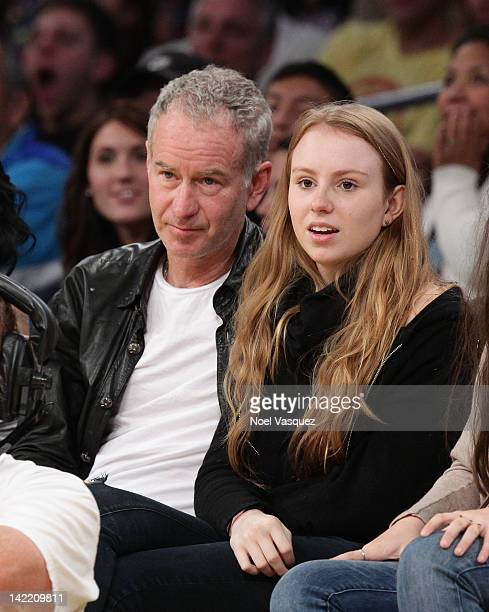 John McEnroe and his daughter Anna McEnroe attend a basketball game between the New Orleans Hornets and the Los Angeles Lakers at Staples Center on...