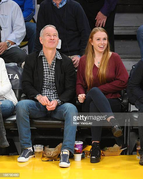 John McEnroe and his daughter Anna McEnroe attend a basketball game between the Portland Trailblazers and the Los Angeles Lakers at Staples Center on...